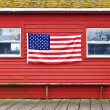 American flag hanging on wall — Stock Photo