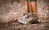 Runner's muddy feet — Stock Photo