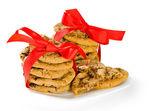 Biscuits enveloppés dans des rubans rouges — Photo