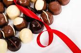 Assortment of dark and white chocolate candies — Stock Photo