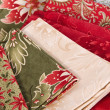 Stockfoto: Quilting fabrics in different colors and patterns