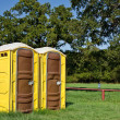 Yellow portable toilets — Stock Photo