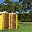 Yellow portable toilets — Stock Photo