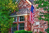House with patriotic American flag — Stock Photo
