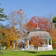 Gazebo surrounded by autumn colors - Stock Photo