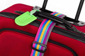 Closeup of luggage tag and colorful belt — Stock Photo