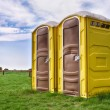 Two yellow portable toilets — Stockfoto