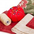 Quilting fabrics with thread and pin cushion — Stock Photo