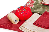 Quiltning tyger med tråd och pin kudde — Stockfoto
