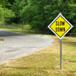Slow Down yellow traffic sign — Stock Photo