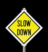 Slow Down yellow road sign isolated — 图库照片