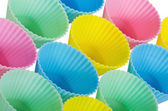 Cupcake baking cups in pastel colors — Stock Photo