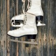 Old ice skates on wall — Stock Photo #33136715