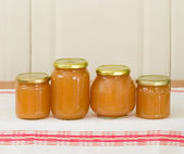 Apple sauce in glass jars — Stock Photo