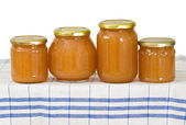 Homemade apple sauce in glass jars — Stok fotoğraf