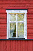 Old white window on red wall — Stock Photo