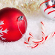 Candy canes and red and silver Christmas balls — Stock Photo #34776517