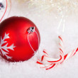 Candy canes and red and silver Christmas balls — Stock Photo #34776521