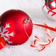 Candy canes with red and silver Christmas ball — Stock Photo #34776541