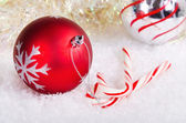 Candy canes and red and silver Christmas balls — Stock Photo