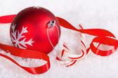 Candy canes and a red Christmas ball — Stockfoto