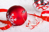 Candy canes with red and silver Christmas ball — Stock Photo