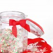 Pinwheel Christmas candies in a glass jar — Stock Photo