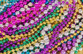 Colorful Mardi Gras beads background — Stock Photo