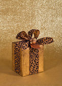 Festive present wrapped in faux leather gift paper — Stock Photo