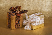 Two festive gift wrapped presents — Stock Photo