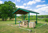 Park picnic area with grill — Stock Photo
