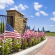 American flags displayed on the street side — Stock Photo