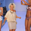Stock Photo: MIAMI - JULY 20: Designer PaolRobb(C) and models walks runway at Poco Pano Collection for S S 2013 during Mercedes-Benz Swim Fashion Week on July 20, 2012 in