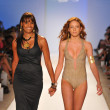 Designer Veronique de la Cruz and a model walk the runway at the Aquarella Swimwear show during Mercedes-Benz Fashion Week Swim 2013 at The Raleigh on July 23, 2012 in Miami, Florida. — Stock Photo