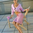 Model  wearing pink couture designer clothes on rooftop - 图库照片