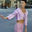 Model wearing pink couture designer clothes on street of  New York City - Stock Photo