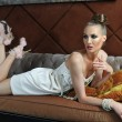 Model wearing couture designer clothes laying on the sofa — Stock Photo