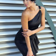 Stock Photo: Model wearing small black couture designer dress