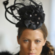 Model wearing designer hats and accessories - Stock Photo