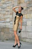 Portrait of fashion model wearing gold dress — Stock Photo