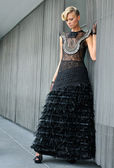 Portrait of model wearing black couture designer gown — Stock Photo