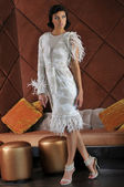 Model wearing couture designer gown in restaurant — Stock Photo