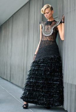 Portrait of model wearing black couture designer gown