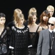 Stock Photo: PARIS, FRANCE - MARCH 08: models walks runway during Chanel Ready to Wear Autumn Winter 2011 2012 show during Paris Fashion Week at Grand Palais on March 8, 2011 in Paris, France.