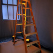 Stepladder stands near a window - Stockfoto