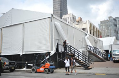 NEW YORK, NY - SEPTEMBER 04 : Workers build a tents during Mercedes-Benz Fashion Week at Lincoln Center on September 04, 2012 in New York City.