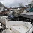 Boats smashed to the ground in the Sheapsheadbay neighborhood due to flooding from Hurricane Sandy - Stock Photo