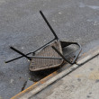 Smashed chair on the ground in the Sheapsheadbay neighborhood due to flooding from Hurricane Sandy - Stock Photo