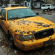 Stock Photo: Yellow cabs all in mud in Sheapsheadbay neighborhood due to flooding from Hurricane Sandy