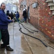 Stock Photo: Pumping water out of building basement in Sheapsheadbay neighborhood due to flooding from Hurricane Sandy in Brooklyn, New York